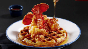Fried Lobster Tails with Sweet Corn Waffles and Spicy Maple Syrup